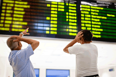 Image of shocked people at airport
