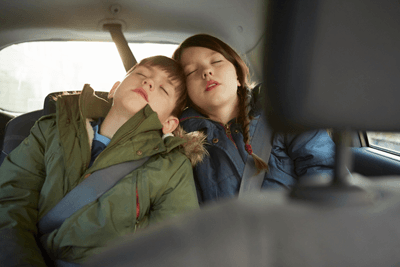 Children asleep in the backseat