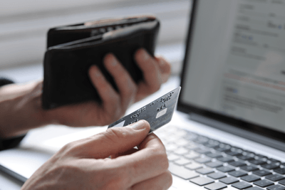 Image of hand holding a credit card