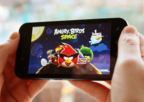 Image of someone playing Angry Birds