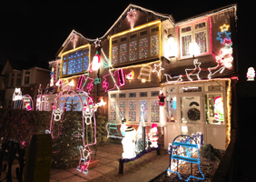 A house bedecked with gaudy christmas lights