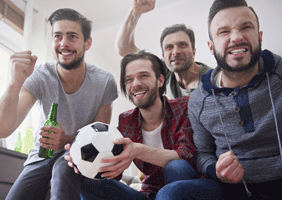 Image of a bunch of lads watching football