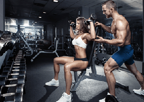 Image of a buff couple working out