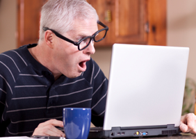 Man looks flustered at computer