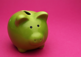 Image of green piggy bank on pink background