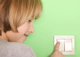 Image of a child touching a switch
