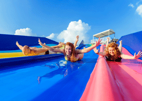 Image of people eImage of people enjoying waterslidesnjoying waterslides