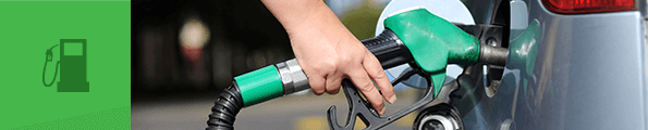 A green fuel pump filling up a car