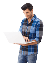 Image of a man looking at a laptop