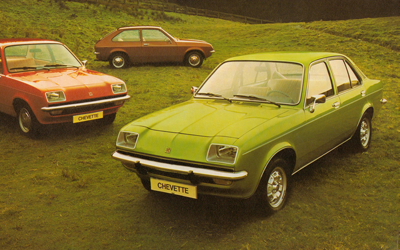 A picture of three Vauxhall Chevettes in a field
