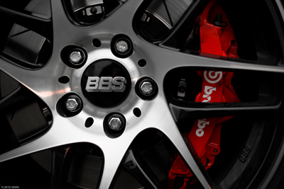 Red brake calipers behind alloy wheel