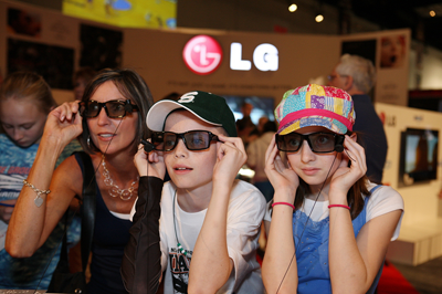 Family watching TV through 3D glasses