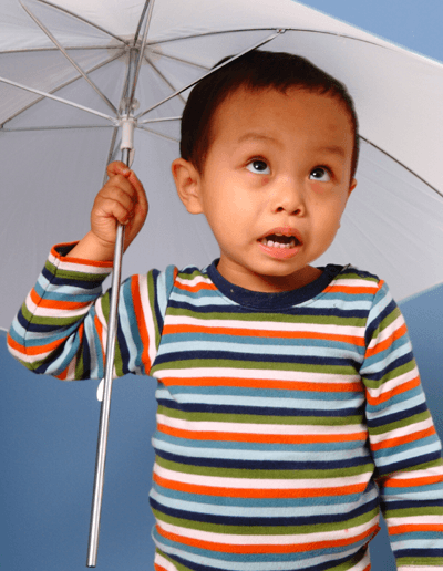 Image of kid with an umbrella