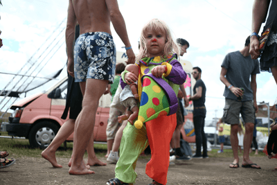 Image of a kid at a festival