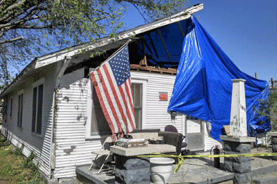 Image of ruined house damaged by tornado in Kansas