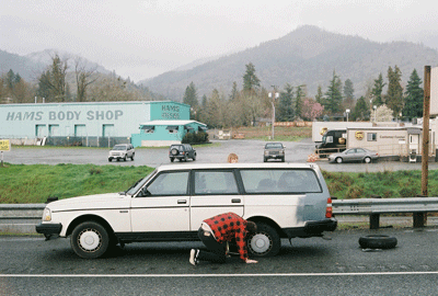 Image of man changing a spare tyre