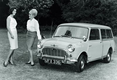 Vintage Mini clubman with two lovely ladies next to it
