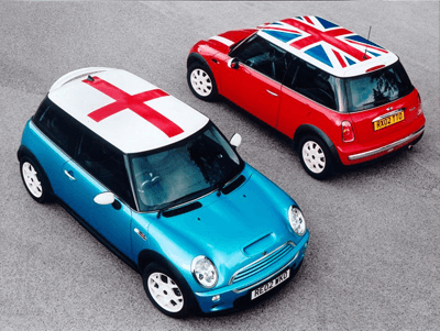 Mini's at vertical angle with St George and Union Jack flags on the roofs