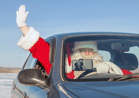 Image of Father Christmas driving a car