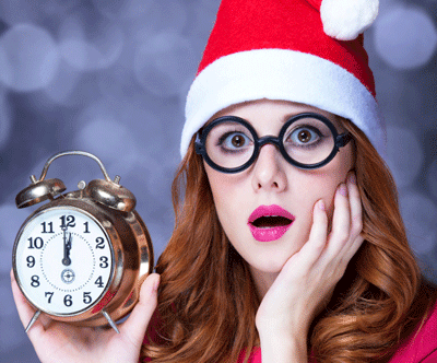 Image of a woman looking worried at Christmas clock