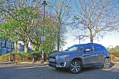 Image of Mitsubishi ASX in front of trees