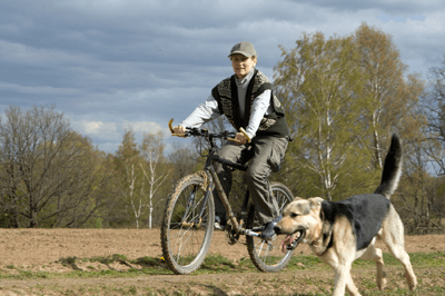 Man cycling with dog