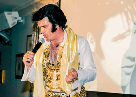 An Elvis tribute act performing at Porthcawl Elvis Festival
