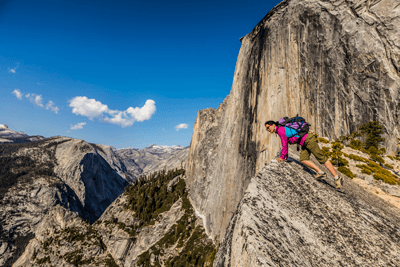 Woman peering over mountain in Yosemite park