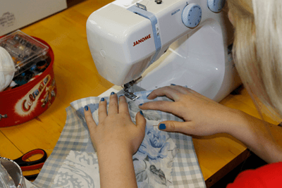 A picture of hands sewing