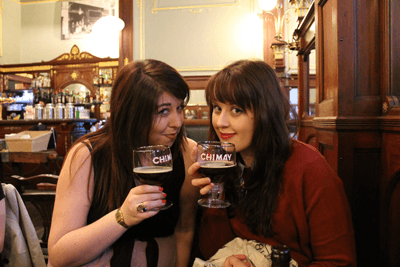 Two ladies drinking belgian trappist beer