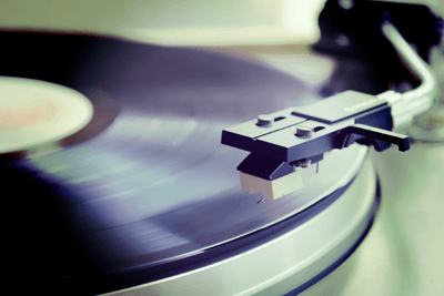 A record player needle and record
