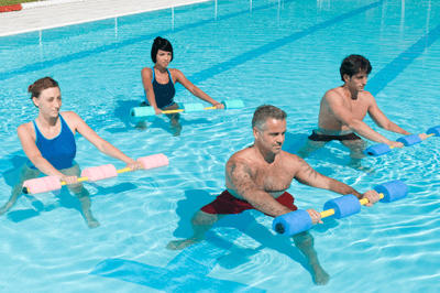 Image of men and women in a pool doing aqua aerobics