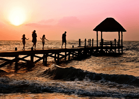 Image of a family on a pier at sunset.