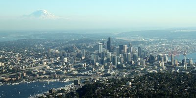 A view of Seattle from the air with Mount Rainier looming over it (photo by by Liesl Matthies)