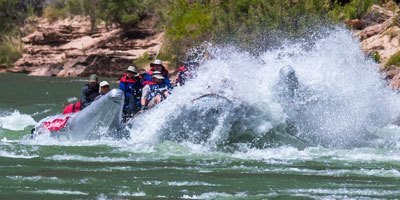 A raft hits a rapid on the Grand Canyon's Colorado River