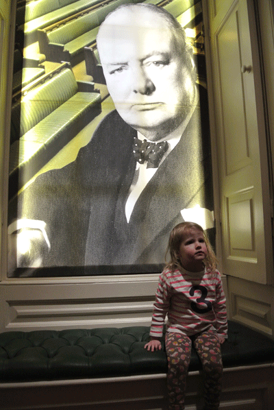 Image of child sitting in front of Winston Churchill picture
