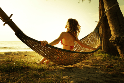 Image of a woman relaxing on a hammock