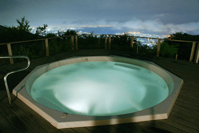 A hot tub overlooking a city skyline