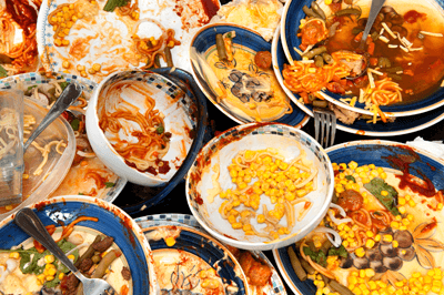 Image of piles of dirty plates