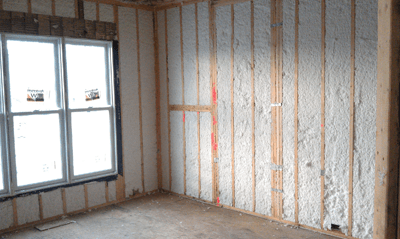 Image of a room with insulation exposed