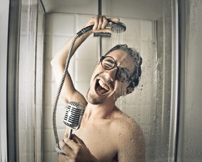 Image of a man singing in the shower