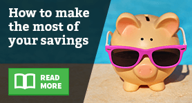 A piggy bank wearing a pair of sunglasses