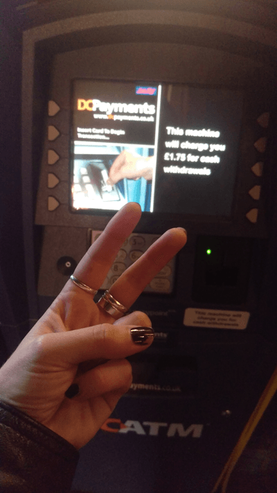 Rachel England flicking the vs at a cash point