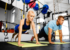 Image of a man and woman mid press up