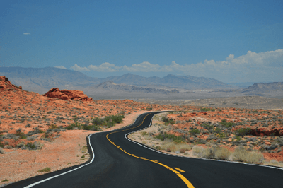Image of a long and winding road through the desert