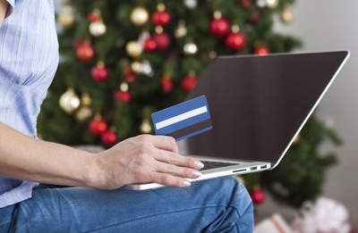 A woman doing some Christmas shopping with a credit card
