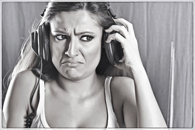 Image of woman listening to questionable music