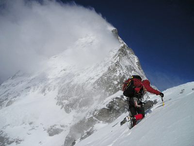 Image of a someone climbing a snowy mountain