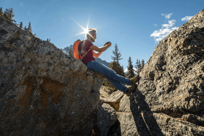 Image of a man taking a selfie while rockclimbing