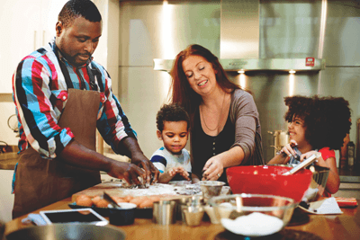 Image of a family cooking up a storm